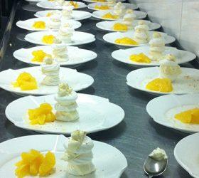 beautiful-meringue-stacks-with-orange-salad-catering-wedding-dessert