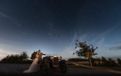 wedding couple under evening sky, with vintage car at Bangor Farm