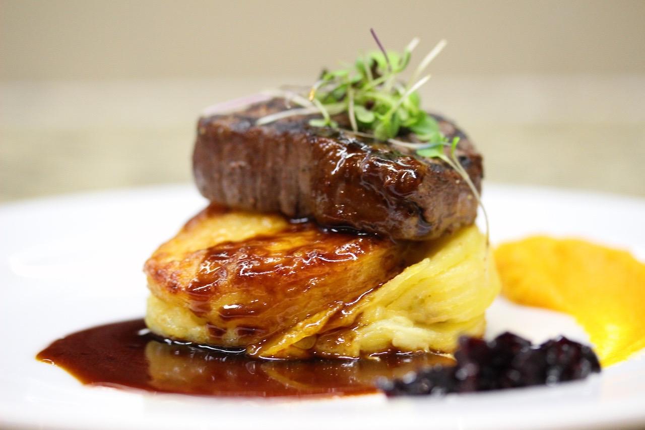fillet steak a a potato gallette plated wedding catering